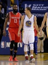 Golden State Warriors guard Stephen Curry (30) smiles next to Houston Rockets guard James Harden (13) during the first half of an NBA basketball game in Oakland, Calif., Wednesday, Jan. 21, 2015. (AP Photo/Jeff Chiu) ORG XMIT: OAS1